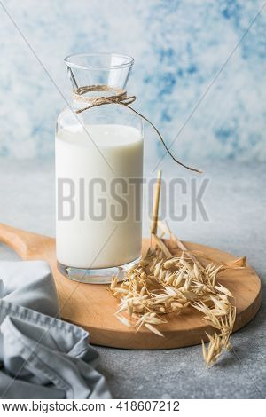 Lactose-free Vegetable Diet Milk. Gluten Free Oat Drink On A Blue Background. Super Food