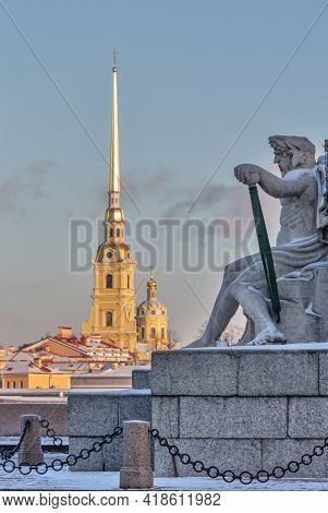 The Peter and Paul Fortress and sculpture near Rostral Column in Saint Petersburg, Russa