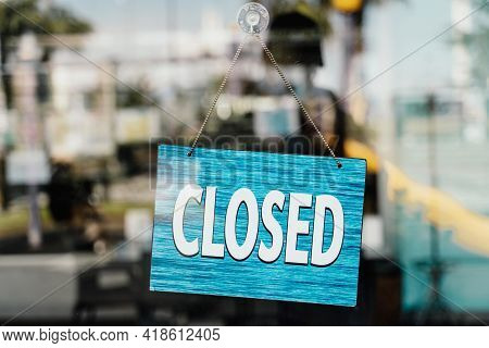 Closed Sign On The Street Cafe Door. Closed Cafes Due To The Corona Virus Pandemic.