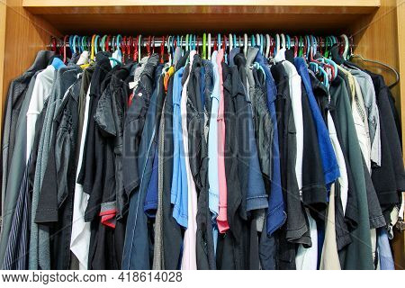 The Clothing Is Very Full In Wardrobe