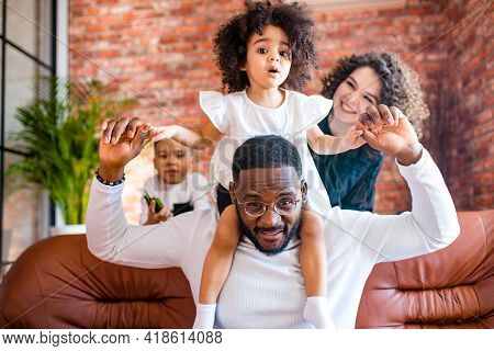 Happy Family With Two Kids Playing At Home