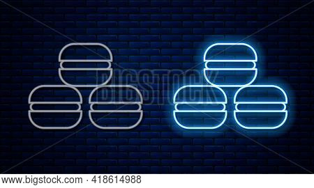 Glowing Neon Line Macaron Cookie Icon Isolated On Brick Wall Background. Macaroon Sweet Bakery. Vect
