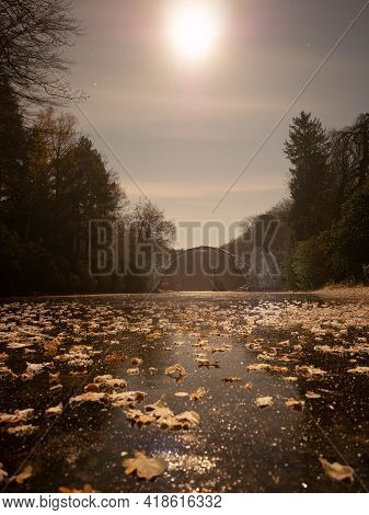 Frosty Night With Full Moon Light. Frozen Lake With Colorful Leaves, Round Rakotzbruecke, The Devil'