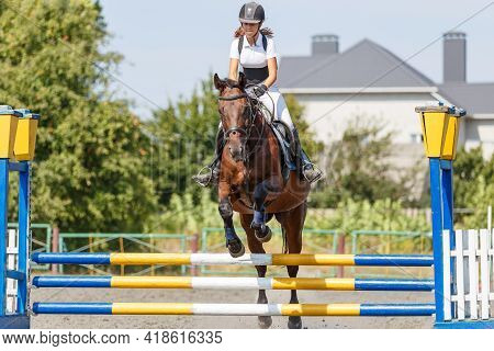 Teen Girl Jumping Horse On Her Show Jumping Course