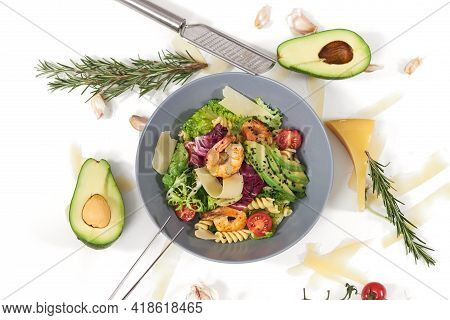 Top View Of Appetizing Salad With Pasta And With Tasty Shrimps And Avocado In Beautiful Blue Plate O