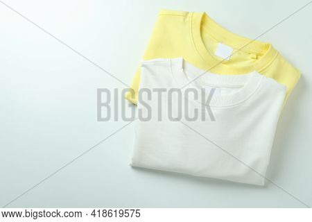 White And Yellow Sweatshirts On White Background