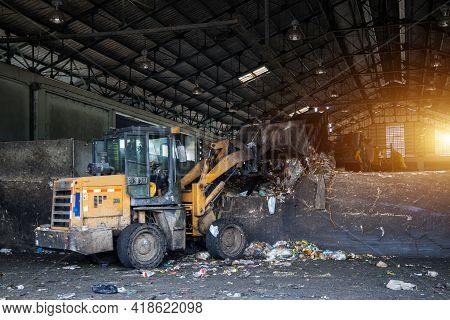 Bulldozer Loads Waste Dump Or Garbage To The Waste Sorting Plant. Industrial For Sorting And Process