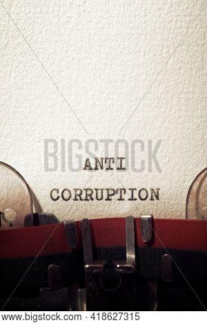 Anti corruption phrase written with a typewriter.