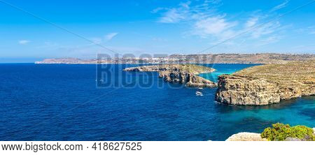 Stone cliffs on the blue lagoon of the island of Comino and Gozo Malta. Mediterranean Sea
