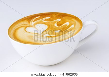 Cappuccino in a white cup on a white background