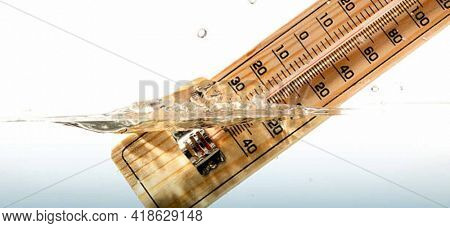 Thermometer measures the temperature of the water. Old fashion water Thermometer