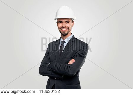 Confident Successful Bearded Male Engineer In Elegant Formal Suit And Hardhat Standing With Arms Cro