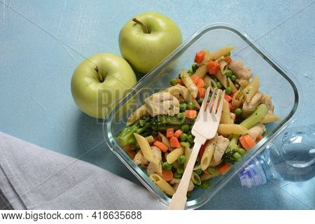 Lunch Box With Pasta Salad, Baked Vegetables And Fried Pieces Of Chicken Breast . Healthy Lunch Conc