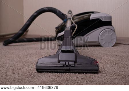 Vacuum Cleaner Black Gray With A Carpet Cleaner. Washing Vacuum Cleaner. Cleaning The House.a Close
