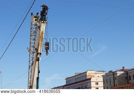 Saint-petersburg, Russia - 10 April 2021: Construction In The City, Street Repair Works. Lifting Cra