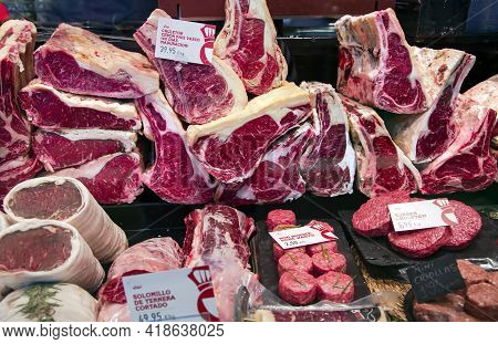 Spain, Barcelona, March, 2021 - Large Chunks Of Fresh Beef Steaks And Other Meat Products At The Far