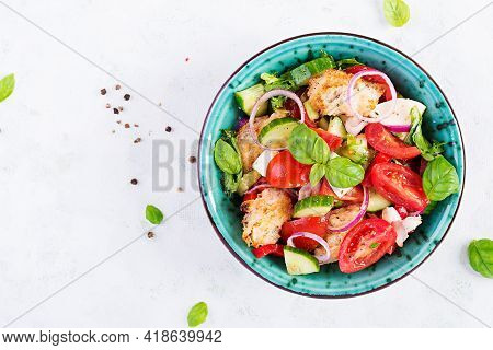 Traditional Italian Tomato Salad Panzanella With Mozzarella, Capers, Red Onion And Croutons. Summer