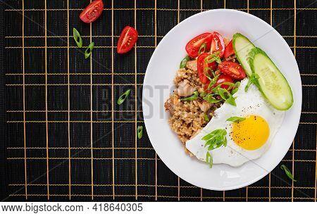 Nasi Goreng. Indonesian Chicken Fried Rice On Dark Background. Nasi Goreng Is An Indonesian Cuisine