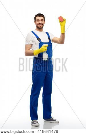 profession, cleaning service and people - happy smiling male worker or cleaner in overal and gloves with sponge and detergent over white background
