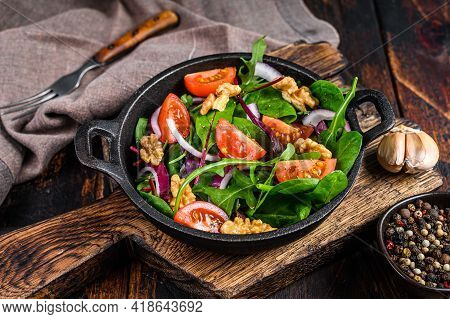 Healthy Bistro Green Salad With Mix Leaves Mangold, Swiss Chard, Spinach, Arugula And Nuts In A Pan.