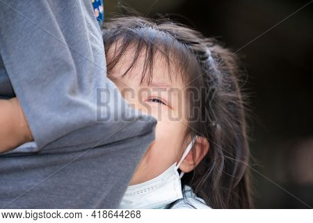 Soft Focus. Asian Kid Is Crying And Regret Nestle On Her Mother's Belly. Mother Used Her Clothes To