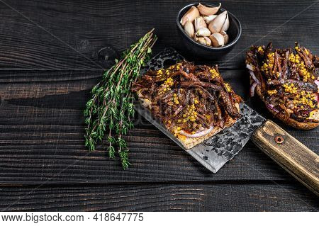 Pulled Pork Sandwich With Smoked Pork Meat On A Meat Cleaver. Black Wooden Background. Top View. Cop