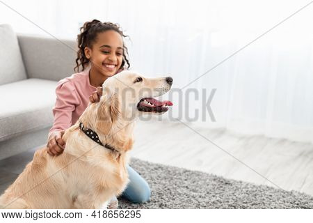 Young Afro Girl Having Fun With Dog At Home
