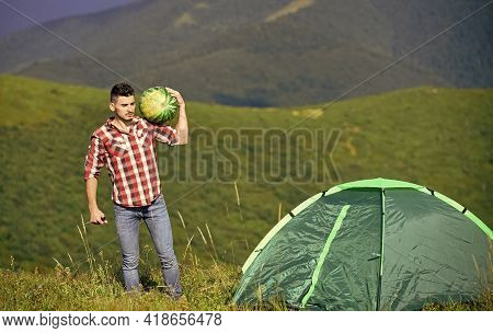Hiker And Camping Tent. Man Bring Watermelon For Picnic In Mountains. Summer Vacation. Pleasant Hike
