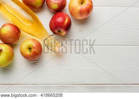 A Bottle Of Apple Cider Vinegar Or Juice With Apples On A White Background With Copy Space. Flat Lay