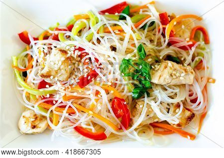 Asian Salad With Glass Noodles, Meat And Vegetables - Carrots, Bell Peppers And Sesame Seeds On A Wh