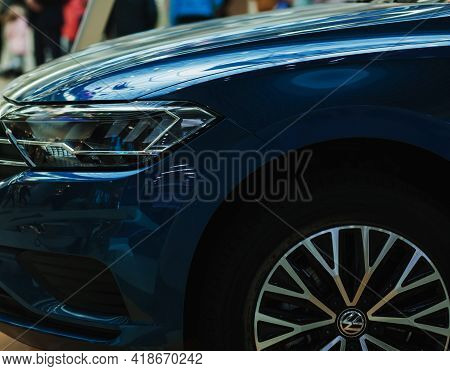 Minsk, Belarus-april 2021: Side Of A Car With Headlights And A Volkswagen Wheel