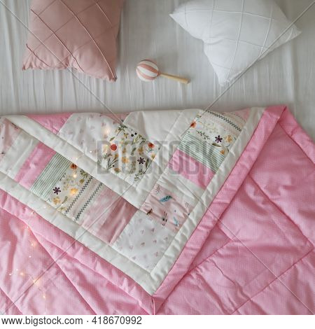 Cozy Baby Cot With A Patchwork Blanket. Baby Bedding And Textile For Nursery