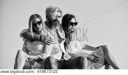 Women And Man Friends Cuddling. Family. Summer Holidays. Relations Friendship Romance. Threesome Con