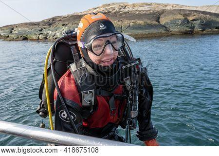 April 17, 2021 - Hamburgsund, Sweden: A Happy Female Scuba Diver Returns To The Dive Boat.