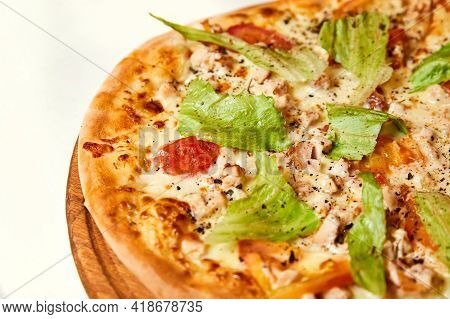 Pizza With Cheese, Bacon, Tomatoes And Lettuce On Wooden Board. Close-up, Selective Focus