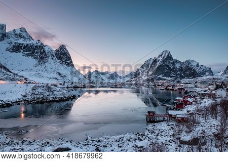 Viewpoint Of Fishing Village With Harbor In Snow Valley And Ice Sea At Morning, Reine, Lofoten, Norw
