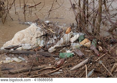 River With Plastic Bottles Left By People. Environmental Disaster Of Water Resources. Plastic Bottle
