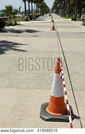 Limassol, Cyprus, April 27th, 2021: Taffic Cones With Barricade Tape On Seafront Promenade Molos Dur