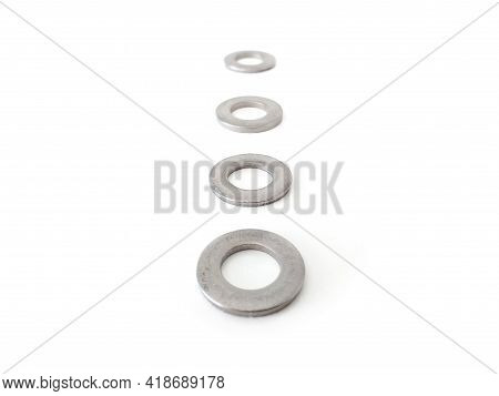 Aerial View And In Diminishing Perspective Of Metal Washers Isolated On White Background. Close Up O