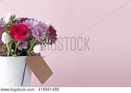 Gift Bouquet Flowers In A White Vase And Empty Label