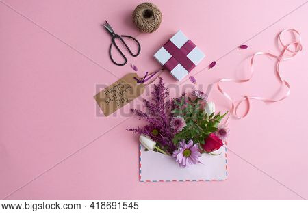 Mothers Day Flowers Inside An Envelope With Greeting Card