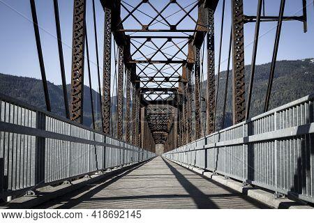An Old Steel Bridge Repurposed Into A Walking Path Near Clark Fork, Idaho.