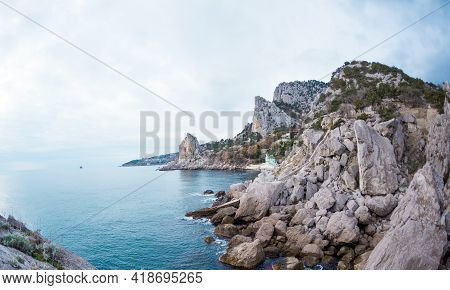 Rocky Coast. Sea On A Winter Cloudy Day. Turquoise Sea Water. Big Stones On The Ocean Coast. The Wav
