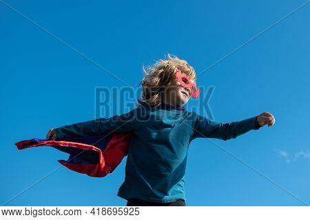 Super Hero Child In A Red Superhero Coat. Super Hero Concept.