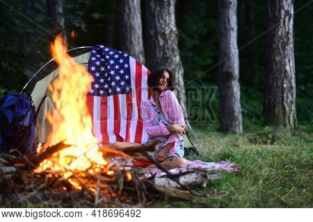 Beautiful Dreamy Girl Enjoy Warm Bonfire And Camping In The Forest. Sensual Girl Sitting Near Fire.