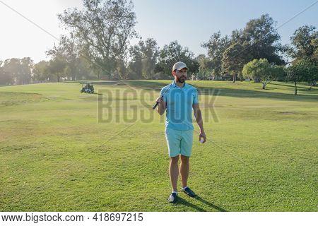 Man Golfer Playing Golf On A Golf Course.