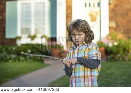 Child Aggression. Negative Kids Emotion. Angry Boy With Stick. Kid Adaptation. Bully.