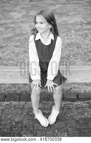 Happy Little Girl Child In Formal School Uniform Sit On Park Bench, Schoolgirl