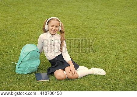 Education Is Safeguard. Cute Girl Listen Music. Happy Preschool Girl With Book In School Yard. Back