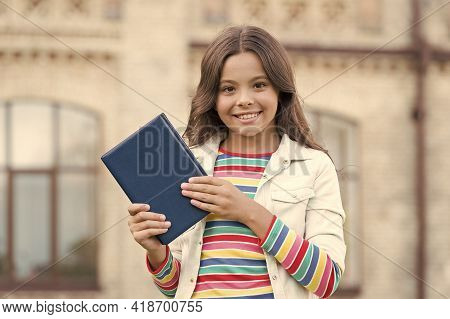 Smart Library Is Open. Happy Child Hold Library Book Outdoors. Little Girl Go To Library. School Lib